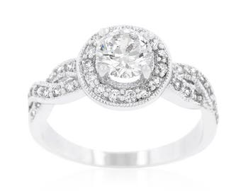 The Halo Ring | Halo style engagement ring fashioned with round cut cubic zirconia and an infinity twisting shank