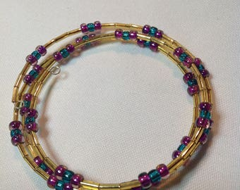 Adjustable memory wire bracelet with purple and gren seed beads and golden bugle beads