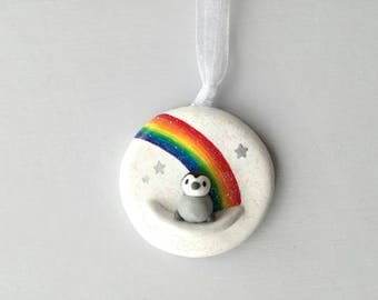Penguin baby and rainbow. Little pottery penguin chick hanger. Hand painted ceramics, baby gift