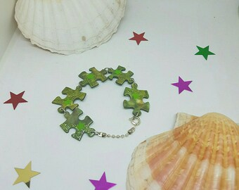 Bracelet in shades of green recycled puzzle pieces