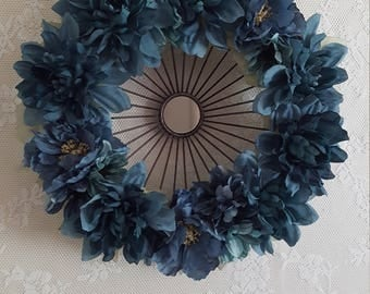 Contemporary mirrored frame with dusty teal blue flowers