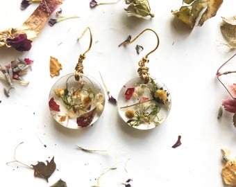 Pendant earrings with details of real dried flower petals and seeds-botanical jewels-resin jewellery-nature