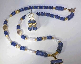 Lapis Rondelle Beads, Pearls and Gold Hearts with a Handmade Pendant.