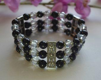 Bracelet, 7 inch handmade dark blue goldstone three strand stretch bracelet