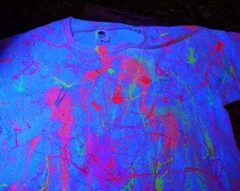 uv reactive colourful neon paint splatter shirt