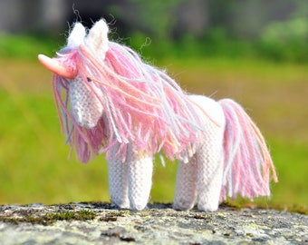White unicorn woolen knitted toy