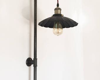 Industrial Design wall lamp with wall stem.