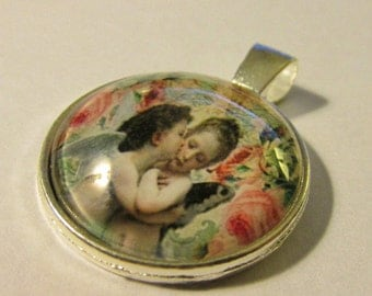 Silver Tone Glass Dome Pendant of Kissing Cherub Angels, 1""