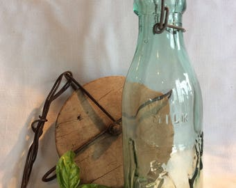 """Vintage dairy bottle embossed cow and dairy farmer pattern quart  9"""" tall kitchen home decor"""