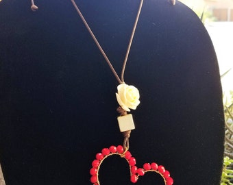 Adjustable collar, with beautiful heart decorated with red Czech crystal.