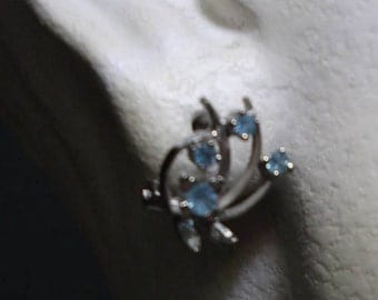 Earrings silver rhodium forming branches with four topazes in light blue