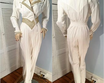 True Vintage 1980's White and Faux Gold Metal Studded Jumpsuit by IIF Zip Pockets Wide Shoulder Pads Crinkle Fabric Dynasty Look Size S/M