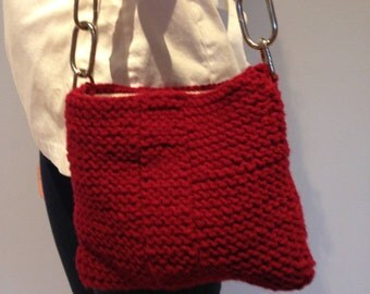 25% off original price until Sept. 8! Knitted purse -red w/ black leather strap. Lined. Wipe clean.
