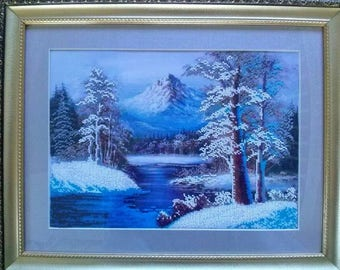 Picture embroidered with beads. Gorgeous winter landscape.