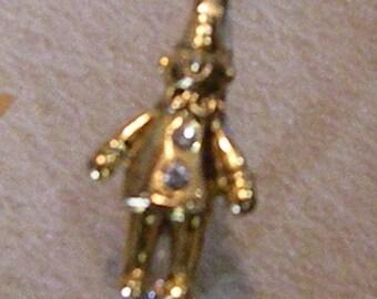 Gold clown pin