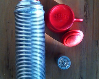 Thermos brand pop top aluminum thermos