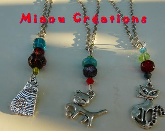 Silver chain with pendant beads and cat. Silver necklace with beads and cat.