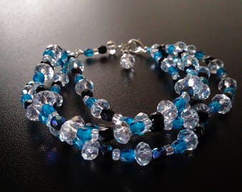 Bracelet 4 rows of crystal, blue and black faceted beads