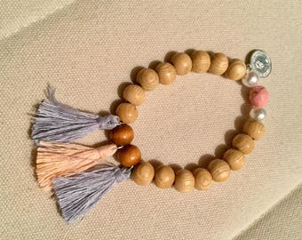 Bracelet with tassel beige/Brown wood beads