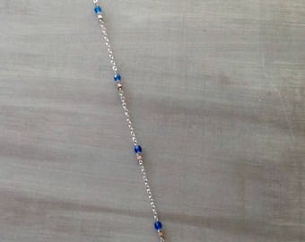 Blue and silver ankle chain
