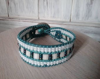 Blue leather strap and glass beads