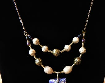 Two-tired beaded necklace and earring set with focal piece