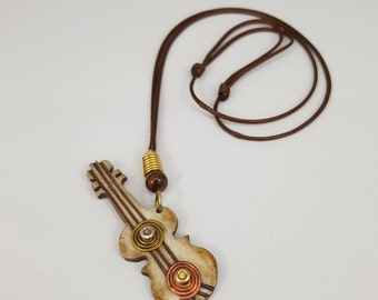 African Bone and Brass Guitar Pendant. African Inspired Jewelry. Hand-Made Pendant. Guitar Pendant. African Guitar. Bone Shaped Guitar