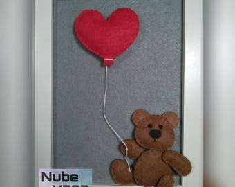 Picture of bear with red heart shaped balloon