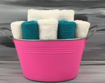 Pink Bathroom Towel/Wash Cloth Bin with metal handles - 1 white hand towel, 5 teal wash cloths and 5 white wash cloths.