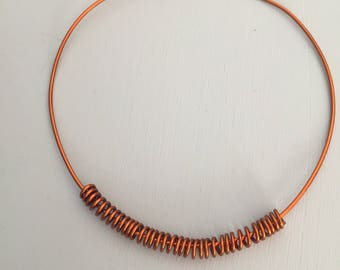 Copper choker necklace with spiral pendant