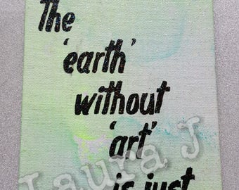 The earth without art quote wall hanging