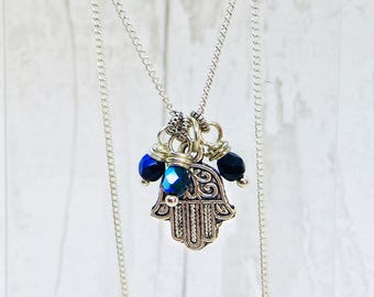 Czech fire polished charm bead necklace. Hamsa hand charm. Black/blue Czech bead charm. 18inch silver plated necklace