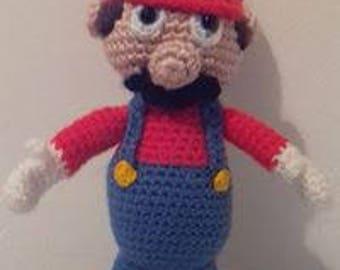Crocheted amigurumi Super Mario doll