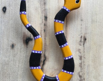 U shape snake pin crafted from wood and painted