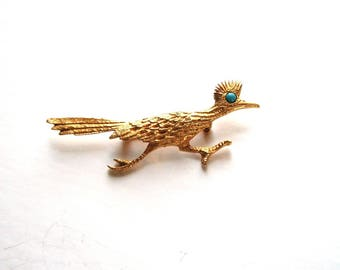 signed vintage J Ritter roadrunner brooch, gold tone with turquoise eye . road runner pin