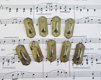 Nine Little Metal Wall Hooks