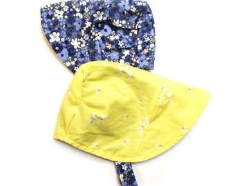 UB2 MIDSUMMER EVE midnight blue flowers and fabulous yellow fireflies lightening bugs on an infant toddler sun hat, by Urban Baby Bonnets