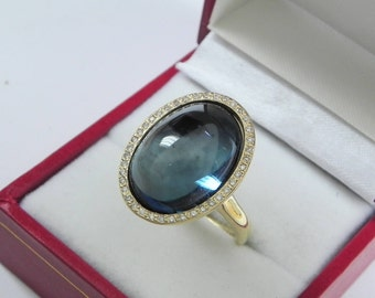 AAAA Blue Topaz 18 x 13mm  14.92 Carats   14K Yellow gold Diamond halo cabochon ring. 1503