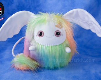 Flibble sprite wing eared creature in pastel rainbow mix; iridescent butterfly accent and Swarovski crystals