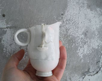 Jug with a rope climbing mouse in white porcelain - handmade ceramic whimsical pitcher