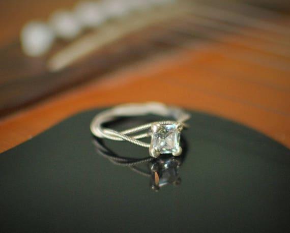 guitar string engagement ring princess cut birthstone ring. Black Bedroom Furniture Sets. Home Design Ideas