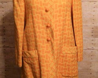 mod dress and coat set A line dress matching orange and yellow knit crosshatch jacket stunning 2 piece iconic madmen tangerine dream set
