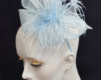 Pale blue baby powder blue ice blue sinamay and feather fascinator on headband fixing ideal weddings races