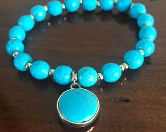 Turquoise beaded bracelet with circular charm