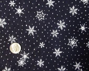 White Snowflakes on Navy Blue Fabric