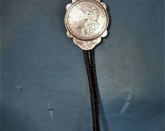 1921 Dollar Bolo Tie - Black Leather Cord - Silver Finish Tips