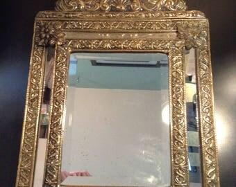 Antique Dutch embossed brass beveled mirror cushion mirror