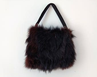 Vintage 1940s black fur muff bag