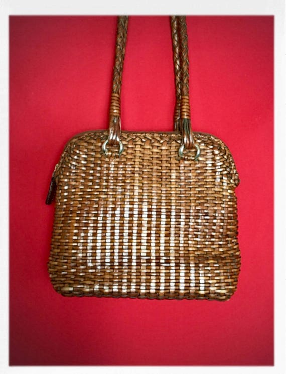 Vintage Woven Leather Handbag with Zip Closure and Adjustable Strap