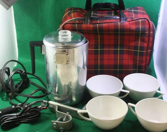 Vintage  (14) piece Empire dual voltage Travel / Glamping  coffee maker with cups and plaid zippered carrying case.